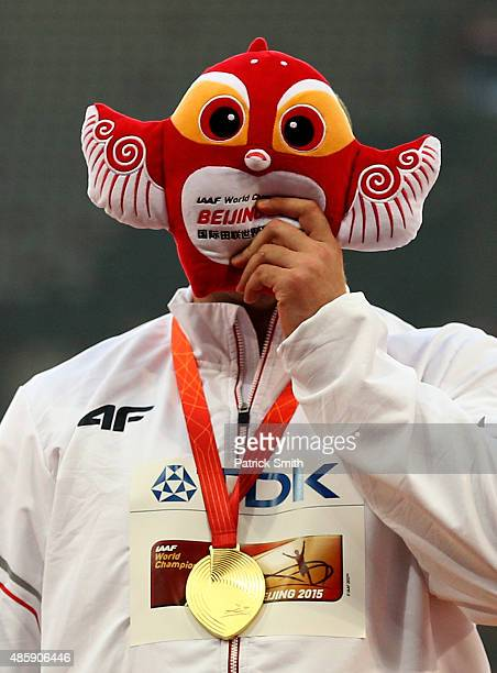 Gold medalist Piotr Malachowski of Poland poses with the mascot Yarner on the podium during the medal ceremony for the Men's Discus final during day...