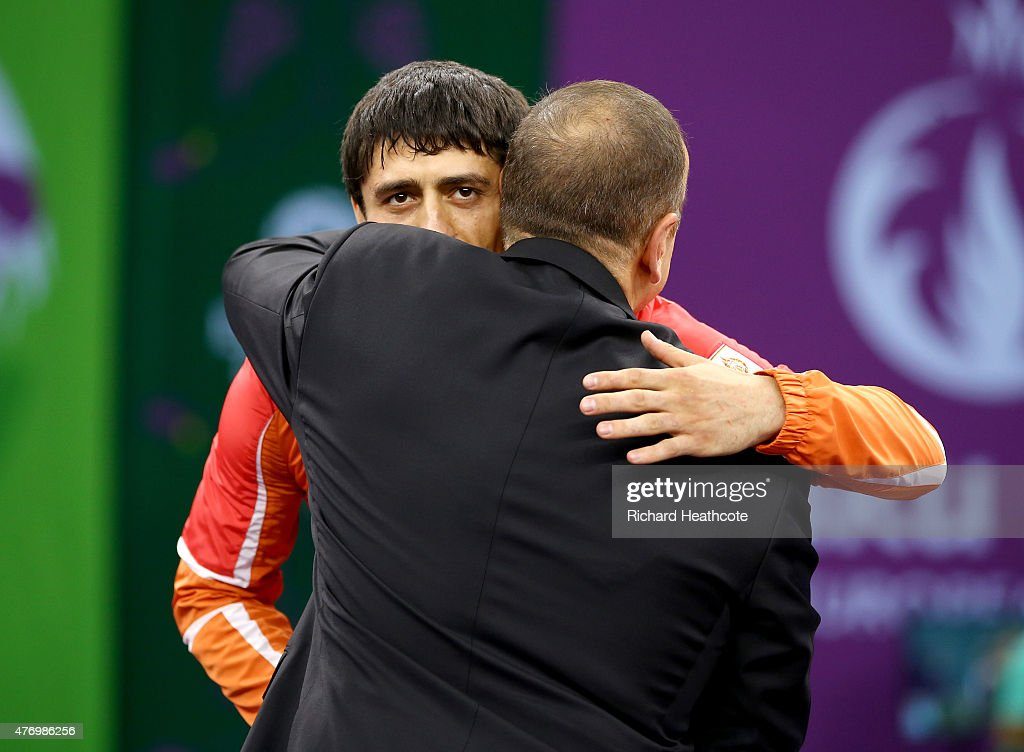 Gold medalist Rasul Chunayev of Azebaijan receives his medal won in the Men's 71kg Greco-Roman final from President of Azerbaijan <a gi-track='captionPersonalityLinkClicked' href=/galleries/search?phrase=Ilham+Aliyev&family=editorial&specificpeople=565601 ng-click='$event.stopPropagation()'>Ilham Aliyev</a> during day one of the Baku 2015 European Games at Heydar Aliyev Arena on June 13, 2015 in Baku, Azerbaijan.