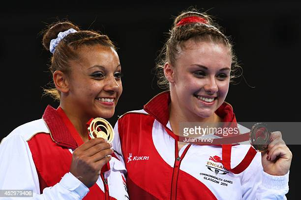 Gold medalist Rebecca and Bronze medalist Ruby Harrold of England pose during the medal ceremony for the Women's Uneven Bars Final at SSE Hydro...
