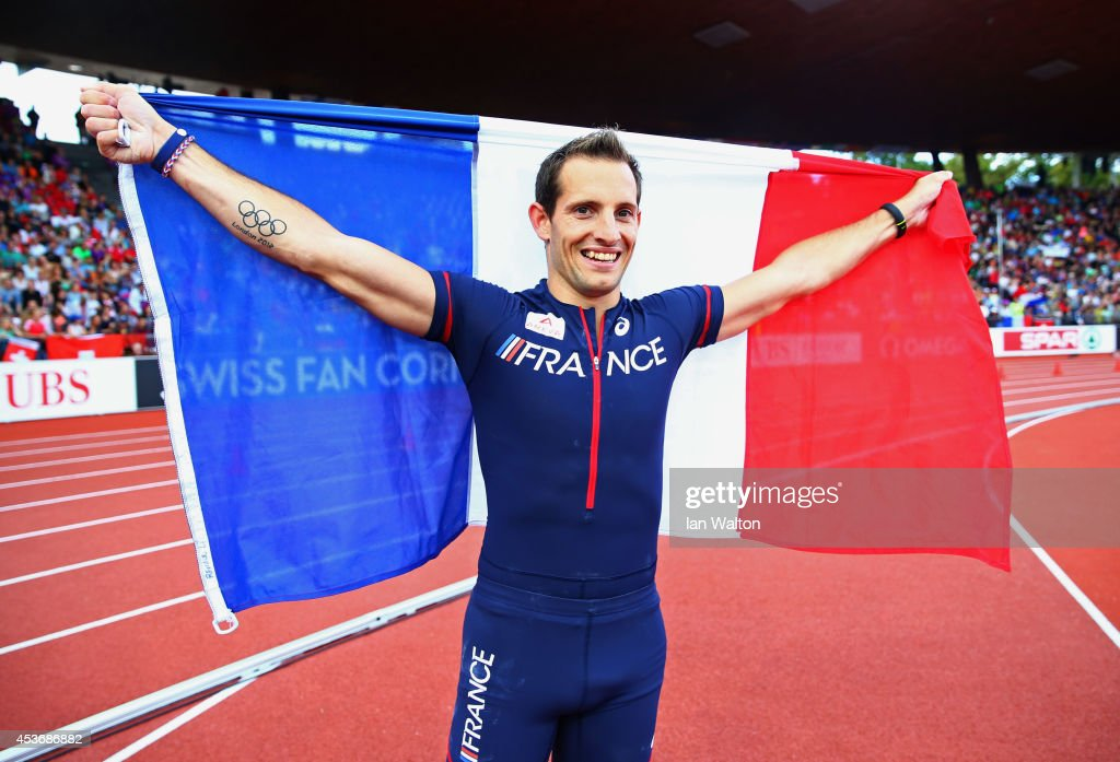 Gold medalist <a gi-track='captionPersonalityLinkClicked' href=/galleries/search?phrase=Renaud+Lavillenie&family=editorial&specificpeople=4955096 ng-click='$event.stopPropagation()'>Renaud Lavillenie</a> of France poses the French national flag after the Men's Pole Vault final during day five of the 22nd European Athletics Championships at Stadium Letzigrund on August 16, 2014 in Zurich, Switzerland.