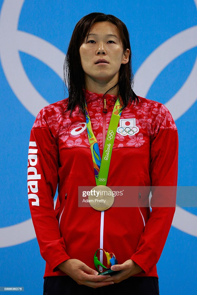 Gold medalist Rie Kaneto of Japan poses on the podium during the medal ceremony for the Women's 200m Breaststroke Final on Day 6 of the Rio 2016...