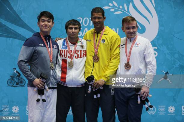 Gold medalist Rinat Kadyrov of Russia silver medalist Jungmu Yang of South Korea and bronze medalists Alexandre Fernandes of Brazil and Arthur...