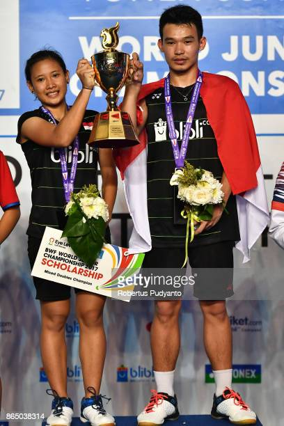 Gold medalist Rinov Rivaldy and Pitha Haningtyas Mentari of Indonesia celebrate on the podium with trophy during Mixed Doubles Final awarding...
