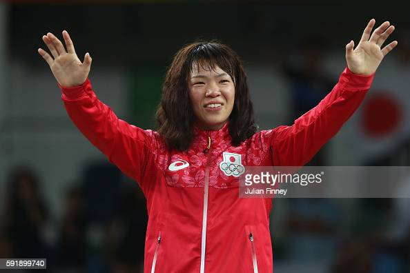 Gold medalist Risako Kawai of Japan celebrates during the medal ceremony following the Women's Freestyle 63 kg competition on Day 13 of the Rio 2016...