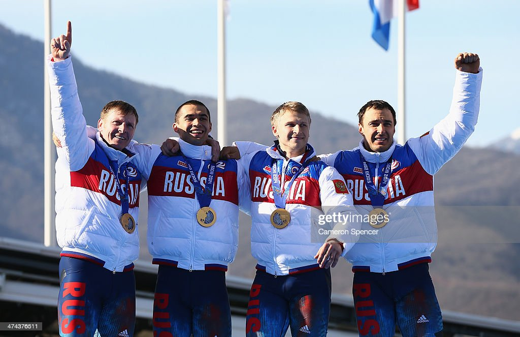 Gold medalist Russia team 1 celebrates on the podium during the medal ceremony for the Four-Man Bobsleigh on Day 16 of the Sochi 2014 Winter Olympics at Sliding Center Sanki on February 23, 2014 in Sochi, Russia.