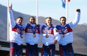 Gold medalist Russia team 1 celebrates on the podium during the medal ceremony for the FourMan Bobsleigh on Day 16 of the Sochi 2014 Winter Olympics...