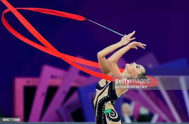 TOPSHOT Gold medalist Russia's Dina Averina performs with her ribbon in Papp Laszlo Arena of Budapest on May 21 2017 during the apparatus final day...