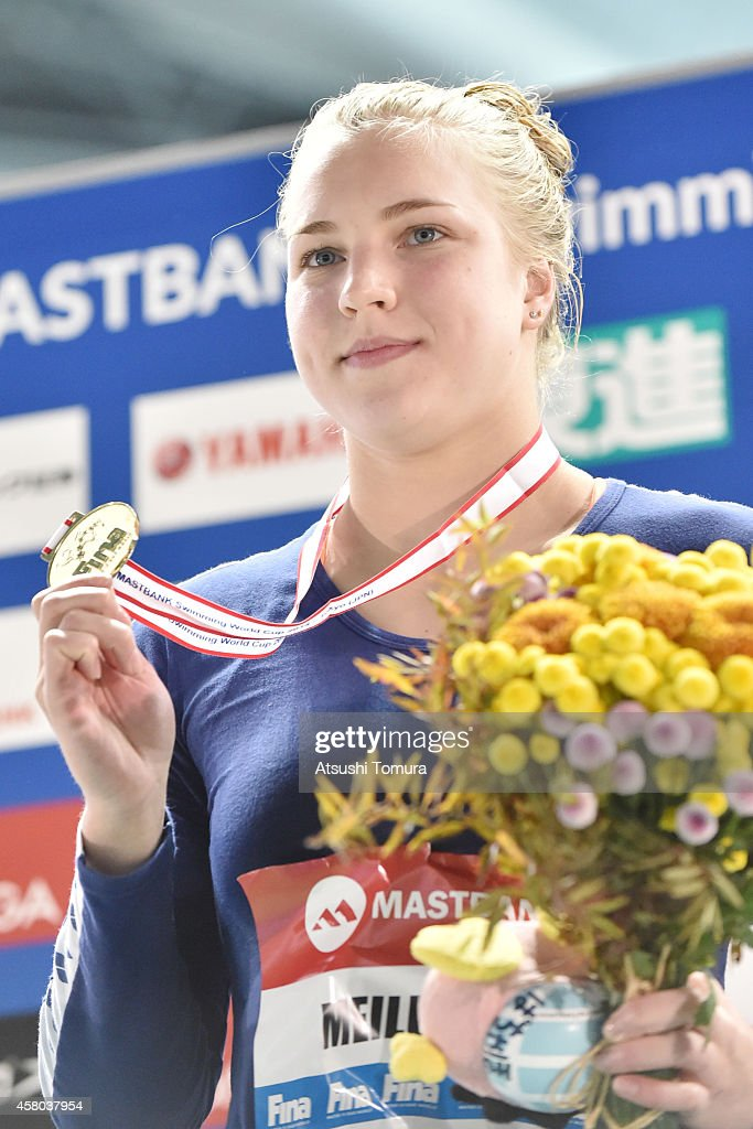 Gold Medalist Ruta Meilutyte of Lithuania celebrates on the podium after the Women's 50m Breaststroke Final during FINA/MASTBANK Swimming World Cup 2014 at Tokyo Tatsumi International Swimming Pool on October 29, 2014 in Tokyo, Japan.