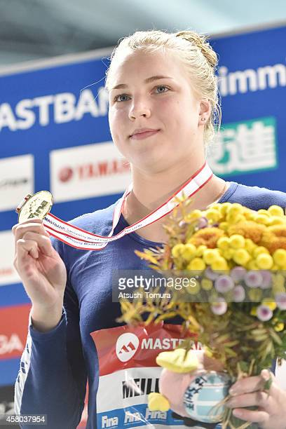 Gold Medalist Ruta Meilutyte of Lithuania celebrates on the podium after the Women's 50m Breaststroke Final during FINA/MASTBANK Swimming World Cup...