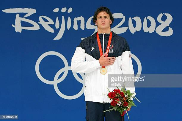 Gold medalist Ryan Lochte of the United States listens to the national anthem from the podium during the medal ceremony for the Men's 200m Backstroke...