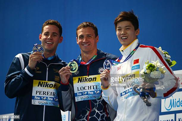 Gold medalist Ryan Lochte of the United States poses with silver medalist Thiago Pereira of Brazil and bronze medalist Shun Wang of China during the...