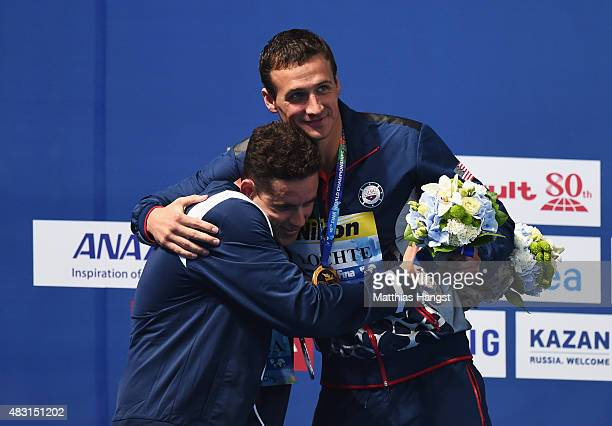 Gold medalist Ryan Lochte of the United States shakes hands with silver medalist Thiago Pereira of Brazil during the medal ceremony for the Men's...