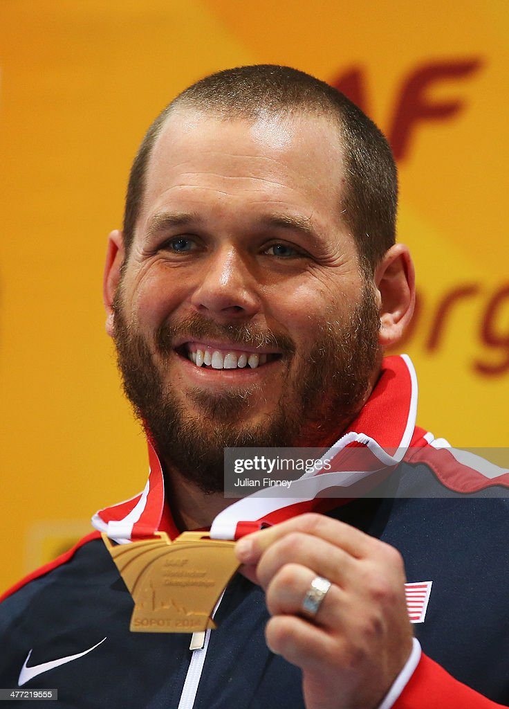 Gold medalist <a gi-track='captionPersonalityLinkClicked' href=/galleries/search?phrase=Ryan+Whiting&family=editorial&specificpeople=7460865 ng-click='$event.stopPropagation()'>Ryan Whiting</a> of the United States poses during the medal ceremony after the Men's Shot Put on day one of the IAAF World Indoor Championships at Ergo Arena on March 7, 2014 in Sopot, Poland.