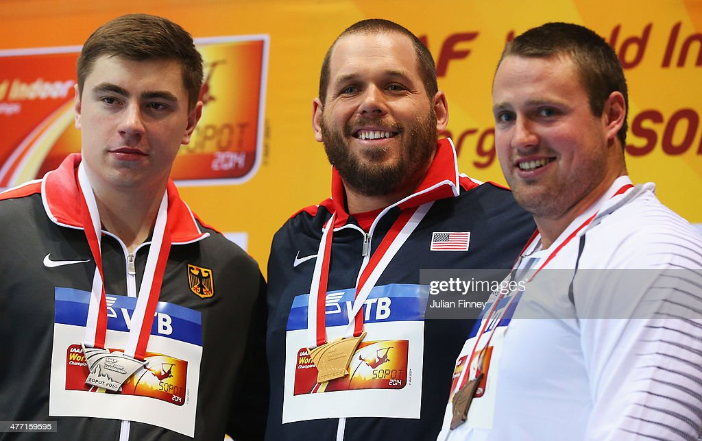 Gold medalist <a gi-track='captionPersonalityLinkClicked' href=/galleries/search?phrase=Ryan+Whiting&family=editorial&specificpeople=7460865 ng-click='$event.stopPropagation()'>Ryan Whiting</a> (C) of the United States poses with silver medalist <a gi-track='captionPersonalityLinkClicked' href=/galleries/search?phrase=David+Storl&family=editorial&specificpeople=4399215 ng-click='$event.stopPropagation()'>David Storl</a> (L) of Germany and bronze medalist Tomas Walsh of New Zealand during the medal ceremony after the Men's Shot Put on day one of the IAAF World Indoor Championships at Ergo Arena on March 7, 2014 in Sopot, Poland.