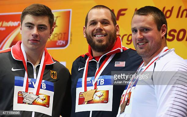 Gold medalist Ryan Whiting of the United States poses with silver medalist David Storl of Germany and bronze medalist Tomas Walsh of New Zealand...