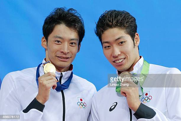 Gold medalist Ryosuke Irie and Bronze medalists Kosuke Hagino of Japan celebrates during the medal ceremony after the swimming Men's 200m Backstroke...