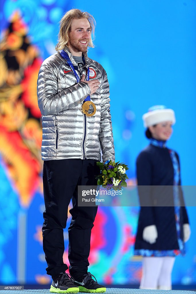 Gold medalist <a gi-track='captionPersonalityLinkClicked' href=/galleries/search?phrase=Sage+Kotsenburg&family=editorial&specificpeople=6711370 ng-click='$event.stopPropagation()'>Sage Kotsenburg</a> of the United States celebrates during the medal ceremony for the Snowboard Men's Slopestyle during day 1 of the Sochi 2014 Winter Olympics at Medals Plaza on February 8, 2014 in Sochi, Russia.
