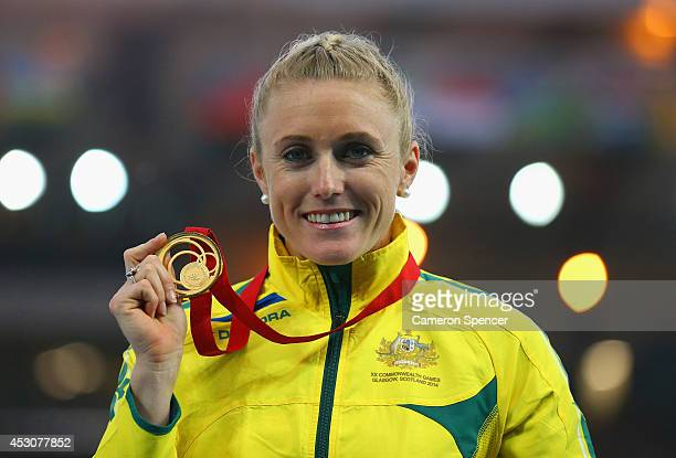 Gold medalist Sally Pearson of Australia poses on the podium during the medal ceremony for the Women's 100 metre hurdlesat Hampden Park during day...