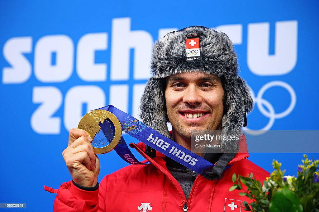 Gold medalist <a gi-track='captionPersonalityLinkClicked' href=/galleries/search?phrase=Sandro+Viletta&family=editorial&specificpeople=5638588 ng-click='$event.stopPropagation()'>Sandro Viletta</a> of Switzerland poses with his medal during the medal ceremony for the Alpine Skiing Men's Super Combined on day 8 of the Sochi 2014 Winter Olympics at Medals Plaza on February 15, 2014 in Sochi, Russia.
