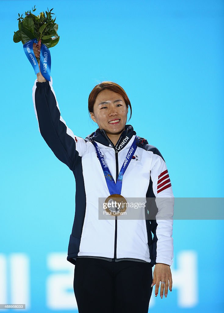 Gold medalist Sang Hwa Lee of South Korea celebrates during the medal ceremony for the Women's 500m on day five of the Sochi 2014 Winter Olympics at Medals Plaza on February 12, 2014 in Sochi, Russia.