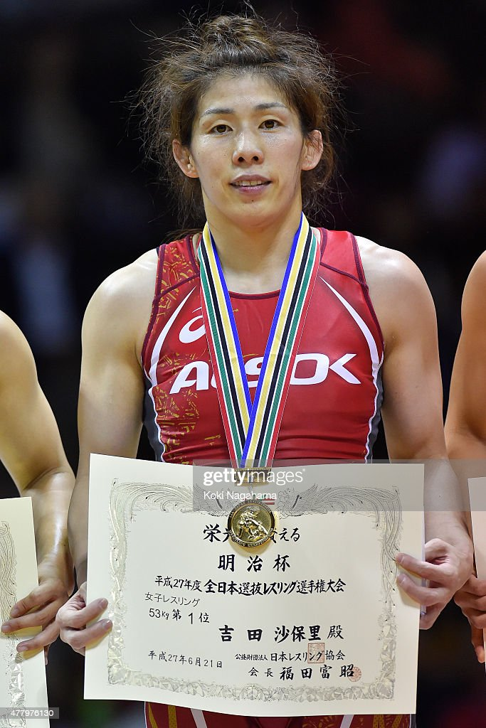 Gold Medalist <a gi-track='captionPersonalityLinkClicked' href=/galleries/search?phrase=Saori+Yoshida&family=editorial&specificpeople=2374710 ng-click='$event.stopPropagation()'>Saori Yoshida</a> poses for photographs on the podium at the award ceremony of the Women's 53kg free style during All Japan Wrestling Championships at Yoyogi National Gymnasium on June 21, 2015 in Tokyo, Japan.