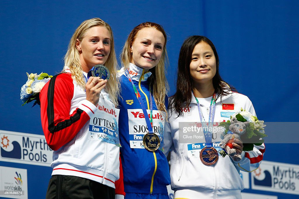 Gold medalist <a gi-track='captionPersonalityLinkClicked' href=/galleries/search?phrase=Sarah+Sjostrom&family=editorial&specificpeople=6000292 ng-click='$event.stopPropagation()'>Sarah Sjostrom</a> (C) of Sweden poses with silver medalist Jeanette Ottesen (L) of Denmark and bronze medalists Ying Lu (R) of China during the medal ceremony for the Women's 100m Butterfly on day ten of the 16th FINA World Championships at the Kazan Arena on August 3, 2015 in Kazan, Russia.