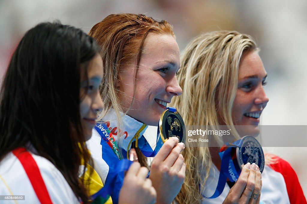 Gold medalist <a gi-track='captionPersonalityLinkClicked' href=/galleries/search?phrase=Sarah+Sjostrom&family=editorial&specificpeople=6000292 ng-click='$event.stopPropagation()'>Sarah Sjostrom</a> (C) of Sweden poses with silver medalist Jeanette Ottesen (R) of Denmark and bronze medalists Ying Lu (L) of China during the medal ceremony for the Women's 100m Butterfly on day ten of the 16th FINA World Championships at the Kazan Arena on August 3, 2015 in Kazan, Russia.
