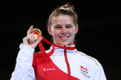 Gold medalist Savannah Marshall of England poses during the medal ceremony for the Women's Middle Final at SSE Hydro during day ten of the Glasgow...