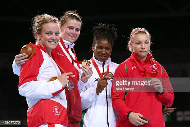 Gold medalist Savannah Marshall of England poses with silver medalist Ariane Fortin of Canada and bronze medalists Edith Ogoke of Nigeria and Lauren...
