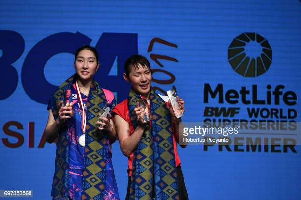 Gold medalist Sayaka Sato of Japan and silver medalist Sung Ji Hyun of Korea celebrate on the podium during Women's Single medals ceremony of the BCA...
