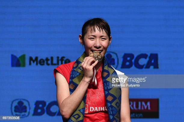Gold medalist Sayaka Sato of Japan celebrates on the podium during Women's Single medals ceremony of the BCA Indonesia Open 2017 at Plenary Hall...