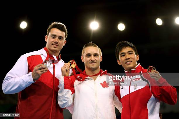 Gold medalist Scott Morgan of Canada poses with silver medalist Kristian Thomas of England and bronze medalist Wah Toon Hoe of Singapore during the...