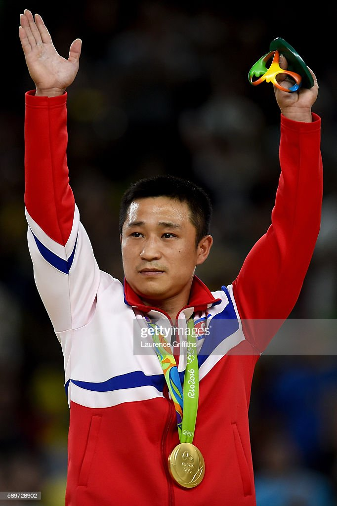 gold medalist Se Gwang Ri of North Korea celebrates on the podium at the medal ceremony for Men's Vault on day 10 of the Rio 2016 Olympic Games at...