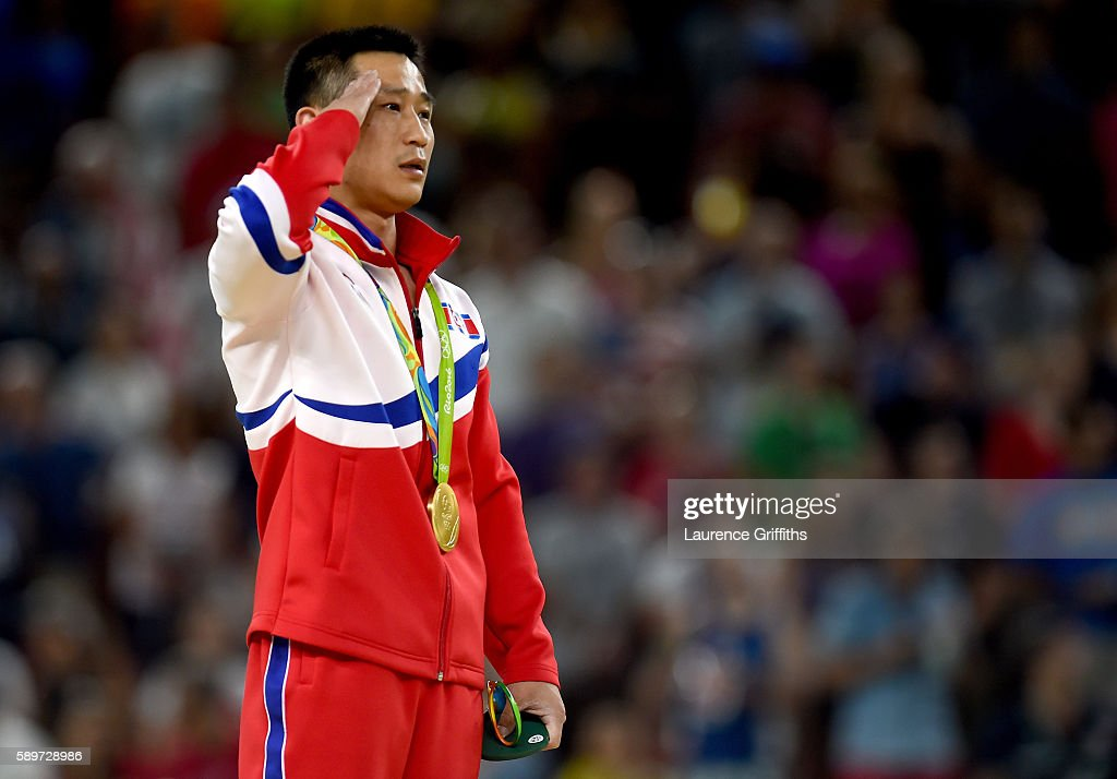 gold medalist Se Gwang Ri of North Korea salutes on the podium at the medal ceremony for Men's Vault on day 10 of the Rio 2016 Olympic Games at Rio...