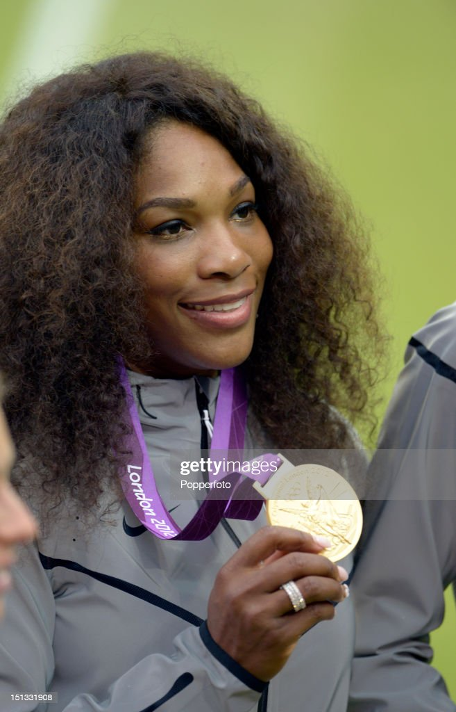 Gold medalist Serena Williams of the United States poses during the medal ceremony for the Women's Doubles Tennis on Day 9 of the London 2012 Olympic Games at the All England Lawn Tennis and Croquet Club on August 5, 2012 in London, England.