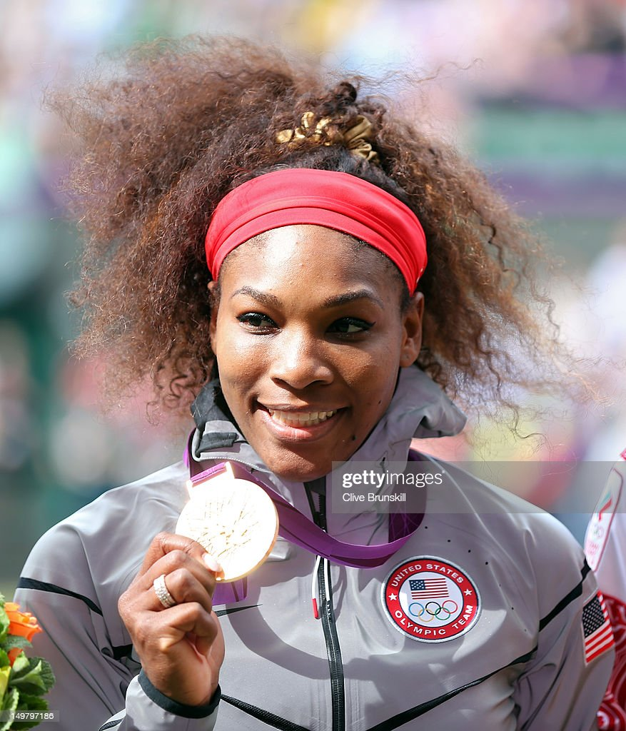 Gold medalist Serena Williams of the United States poses on the podium during the medal ceremony for the gold medal match of the Women's Singles...