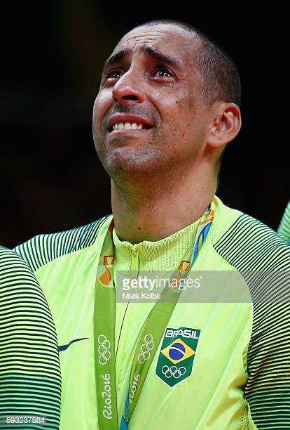 Gold medalist Sergio Dutra Santos of Brazil celebrates during the medal ceremony of the Men's Gold Medal Match between Italy and Brazil on Day 16 of...