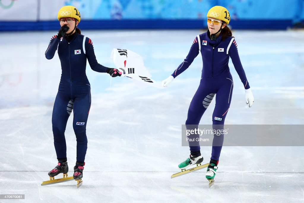 Gold medalist Seung-Hi Park (L) and bronze medalist Suk Hee Shim of South Korea celebrate in the Short Track Women's 1000m Final A on day fourteen of the 2014 Sochi Winter Olympics at Iceberg Skating Palace on February 21, 2014 in Sochi, Russia.