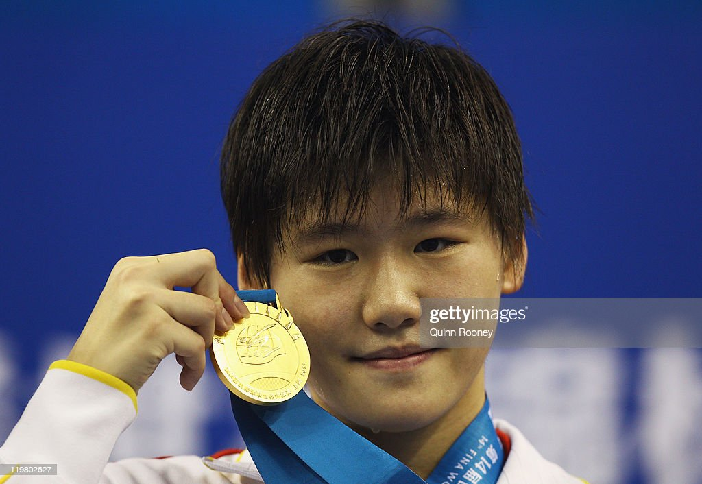 Gold medalist Shiwen Ye of China poses for a photo on the podium with her gold medal during the medal ceremony for the Women's 200m Individual Medley final on Day Ten of the 14th FINA World Championships at the Oriental Sports Center on July 25, 2011 in Shanghai, China.