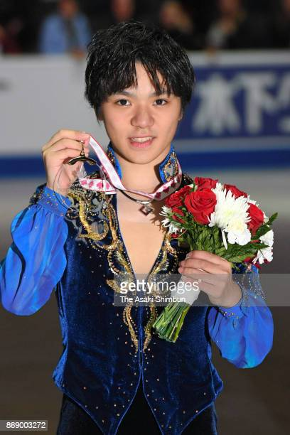 Gold medalist Shoma Uno of Japan poses for photographs after the medal ceremony for the Men's Singles during day two of the ISU Grand Prix of Figure...