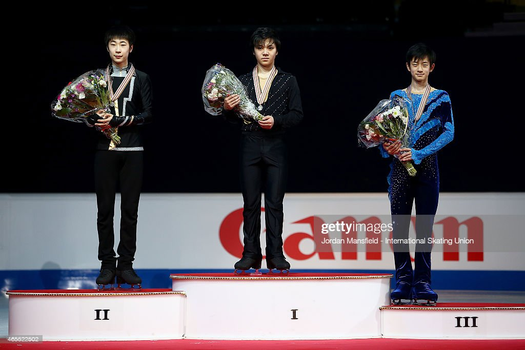 Gold medalist Shoma Uno of Japan (C), Silver medalist Boyang Jin of China (L) and Bronze medalist Sota Yamamoto of Japan (R) pose for a picture after winning the Junior Men's Competition on Day 4 of the ISU World Junior Figure Skating Championships at Tondiraba Ice Arena on March 7, 2015 in Tallinn, Estonia.