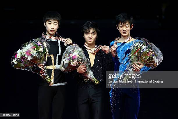 Gold medalist Shoma Uno of Japan Silver medalist Boyang Jin of China and Bronze medalist Sota Yamamoto of Japan pose for a picture after winning the...