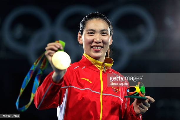 Gold medalist Shuyin Zheng of China celebrates on the podium during the medal ceremony for the Taekwondo Women 67kg Gold Medal Contest on Day 15 of...
