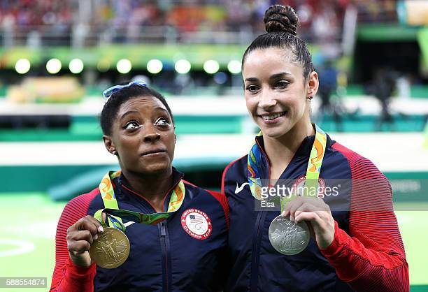 Gold medalist Simone Biles of the United States and silver medalist Alexandra Raisman of the United States pose for photographs after the medal...