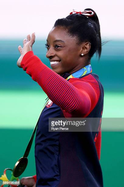 Gold medalist Simone Biles of the United States waves after the medal ceremony for Women's Vault on Day 9 of the Rio 2016 Olympic Games at the Rio...
