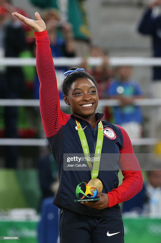 Gold medalist Simone Biles of USA poses during the medal ceremony for the Women's Individual AllAround Final on day 6 of the Rio 2016 Olympic Games...