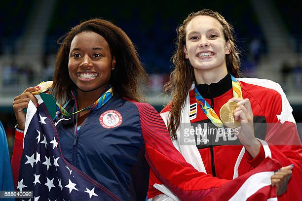 Gold medalist Simone Manuel of the United States and gold medalist Penny Oleksiak of Canada celebrate during the medal ceremony for the Women's 100m...