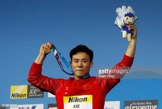 Gold medalist Siyi Xie of China poses with the medal won during the Men's 3M Springboard final on day seven of the Budapest 2017 FINA World...