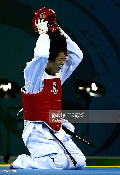 Gold medalist Son Taejin of South Korea celebrates winning the Men 68kg Taekwondo gold medal contest at the Beijing Science and Technology University...