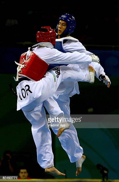 Gold medalist Son Taejin of South Korea competes against Mark Lopez of the United States in the Men 68kg Taekwondo gold medal contest at the Beijing...